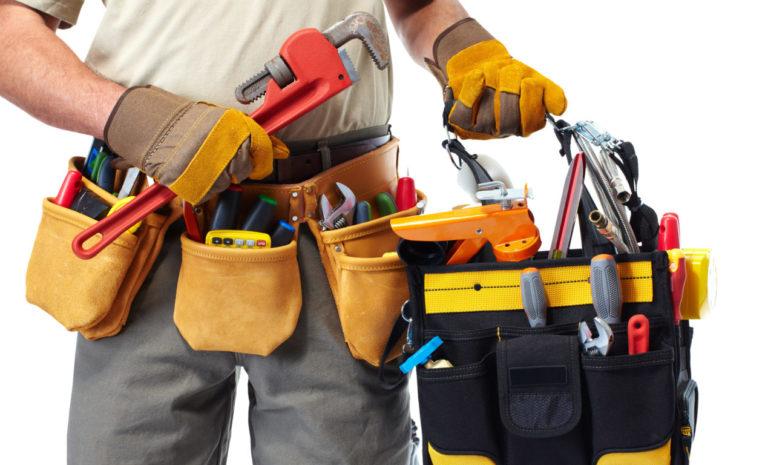 handyman in las vegas holding tool bag