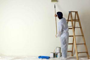 painter using paint roller